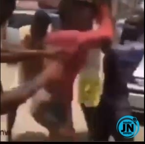 Angry Nigerian youths beat up a crossdresser